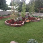 Raised flower bed to create a focus point in yard